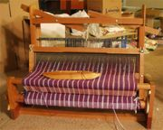 Four harness table loom.