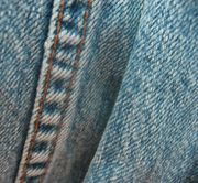 Part of a pair of denim blue jeans