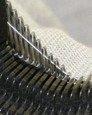 A modern industrial knitting machine in action